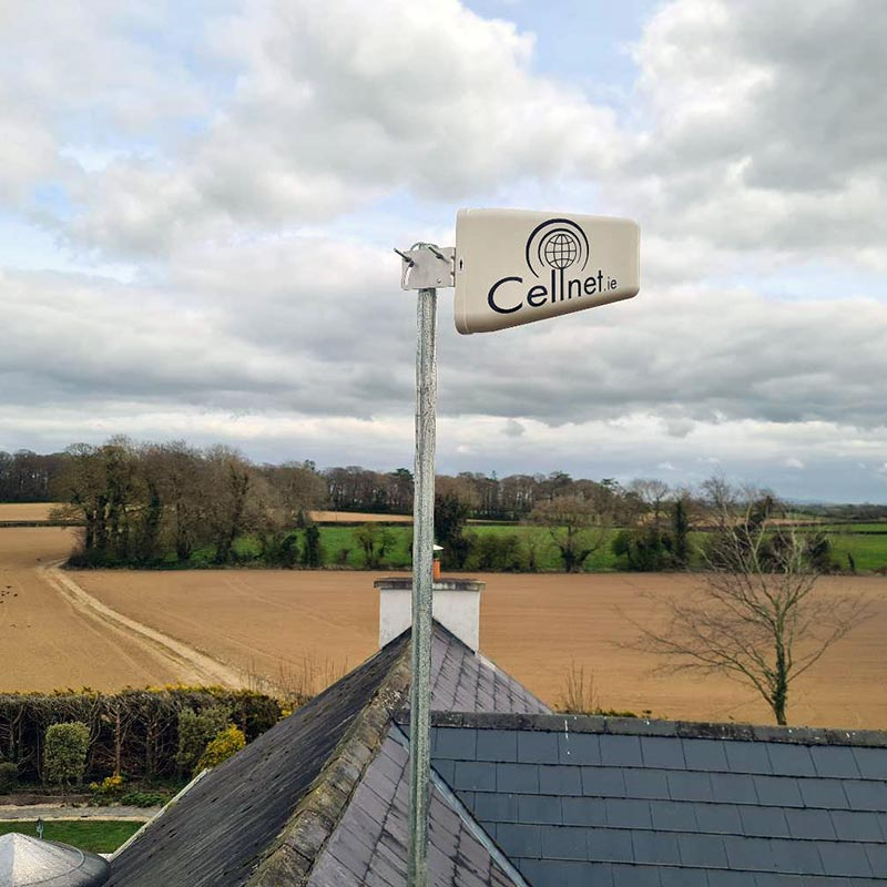 Cellnet mast on top of a roof, providing rural broadband and wifi